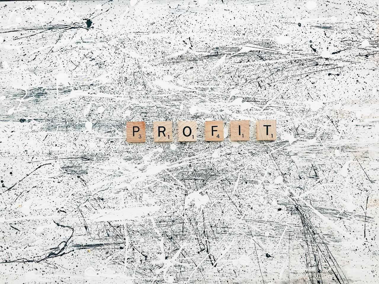 "Word ""profit"" on abstract background"